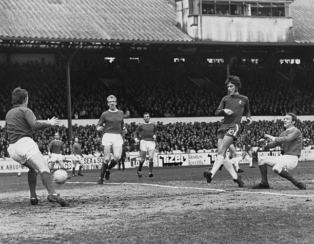 Centre Forward Ian Hutchinson of Chelsea shoots the ball past Manchester United goalkeeper Alex Stepney and centre half Ian Ure to score as...