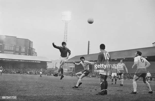 Centre forward Mick Hill of Ipswich Town FC heads the ball during a match against West Bromwich Albion UK 13th December 1969