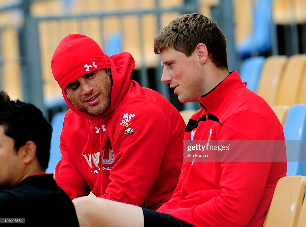 Centre Jamie Roberts (L) and flyhalf Rhys Priestland (R) look on from the stands during a Wales IRB Rugby World Cup 2011 training session at Mt Smart Stadium on October 11, 2011 in Auckland, New Zealand.