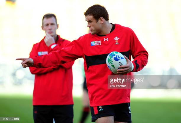 Centre Jamie Roberts speaks with Wales assistant coach Rob Howley during a Wales IRB Rugby World Cup 2011 training session at Mt Smart Stadium on...