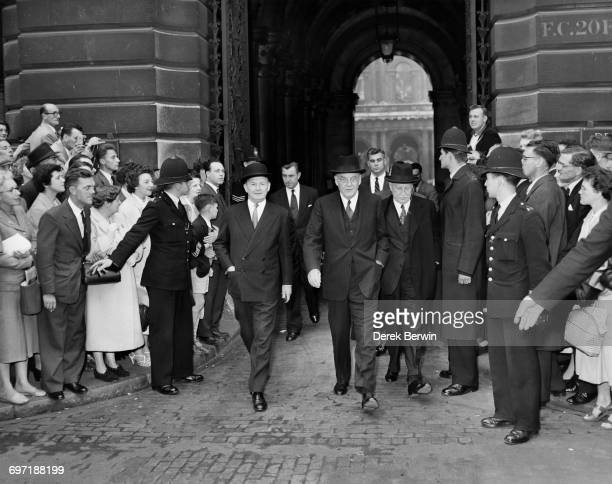 British Foreign Secretary Selwyn Lloyd US Secretary of State John Foster Dulles and American ambassador Winthrop W Aldrich leaving the Foreign Office...