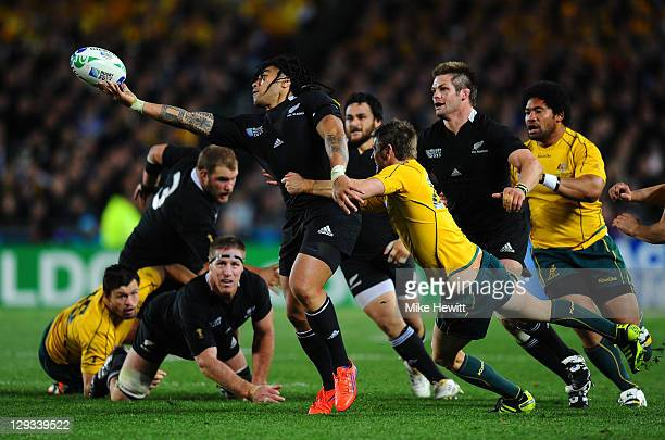 Centre Ma'a Nonu of the All Blacks looses the ball as he is tackled by Robert Horne of the Wallabies during semi final two of the 2011 IRB Rugby...