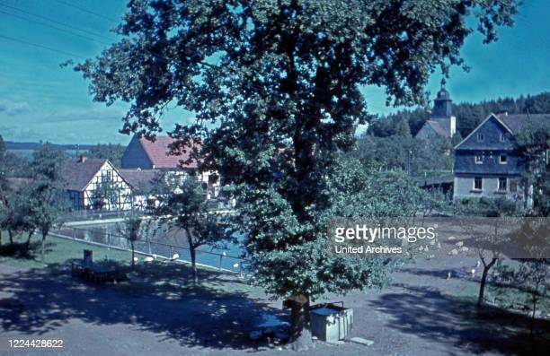 Centre of the village Traun Thuringia with well, Germany 1930s.