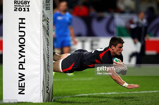 Centre Scott Williams of Wales dives over to score his team's fourth try during the IRB 2011 Rugby World Cup Pool D match between Wales and Namibia...