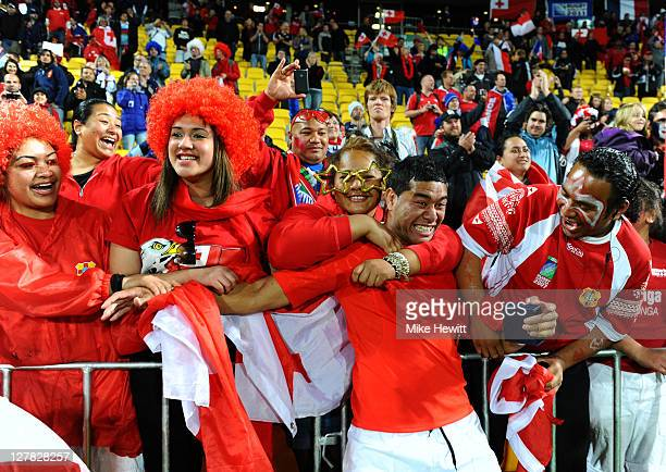 Centre Siale Piutau of Tonga celebrates with the fans following his team's 1419 victory during the IRB 2011 Rugby World Cup Pool A match between...