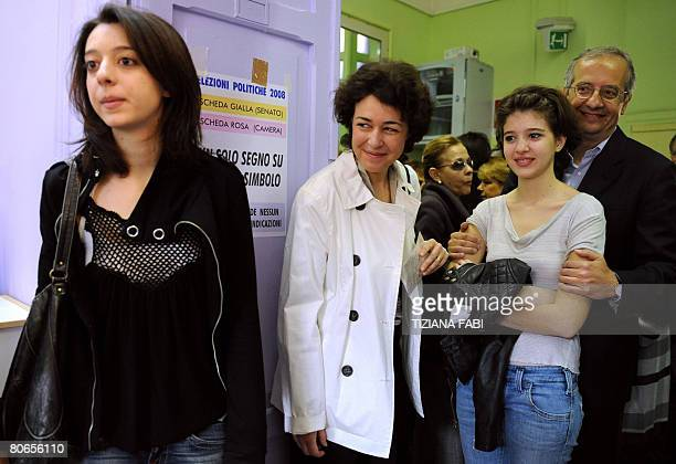 Centre-left leader Walter Veltroni arrives with her daughters Martina , Vittoria and his wife Flavia at a polling station in Rome on April 13, 2008....