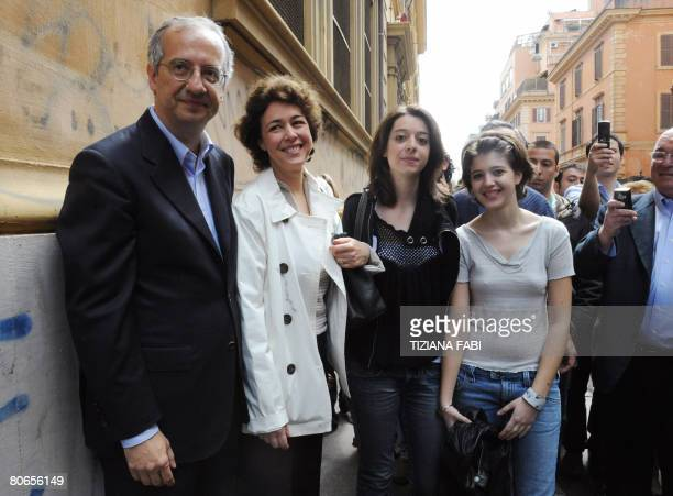 Centreleft leader Walter Veltroni poses with his wife Flavia and his daughters Martina and Vittoria after leaving the polling station in Rome on...