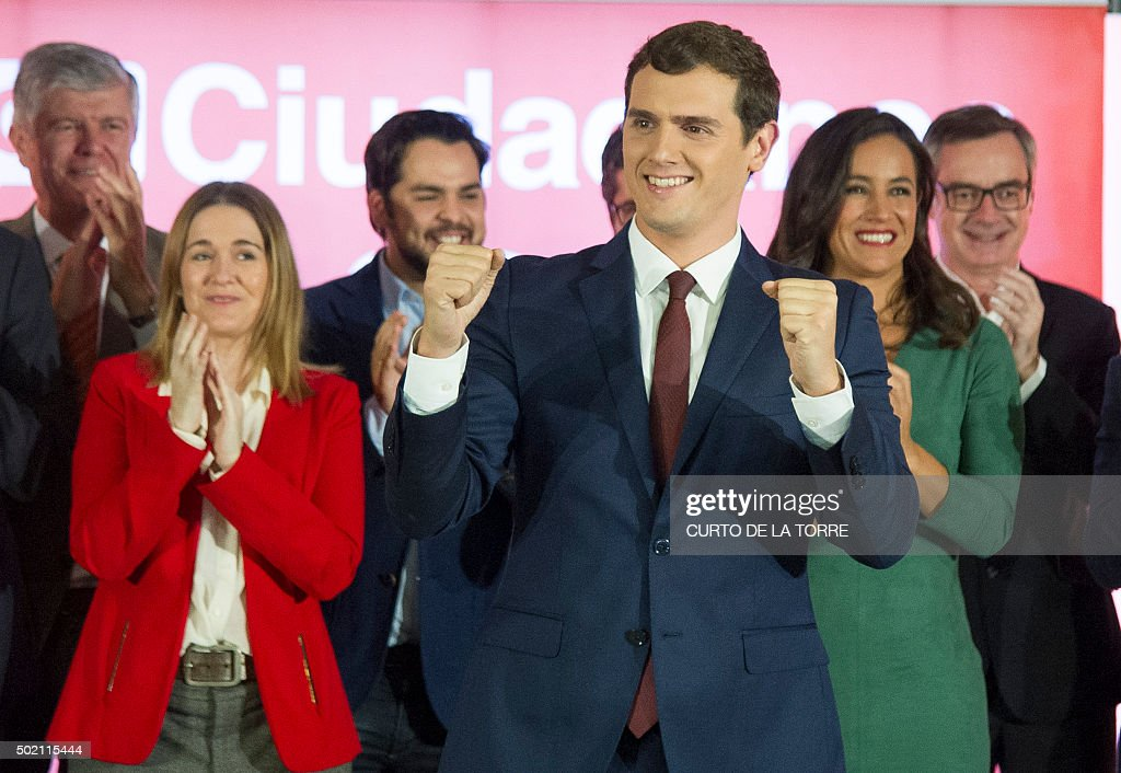 Centre-right party Ciudadanos leader and candidate for the general election, Albert Rivera (C) gestures after the results of Spain's general election in Madrid on December 20, 2015. Spain's ruling conservative Popular Party won the most seats in parliament in a general election today but lost its absolute majority, partial results showed with over 80 percent of votes counted.
