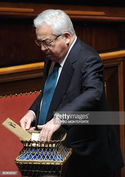 Centreright senator Giuseppe Ciarrapico casts his vote for the election of Italy's Senate President of the 13th legislature in Rome's Palazzo Madama...