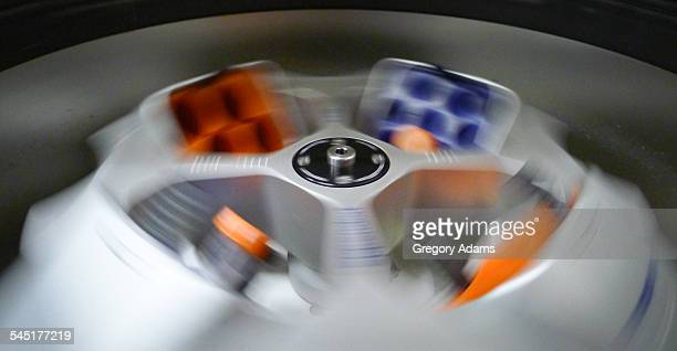 A centrifuge spinning in a research laboratory