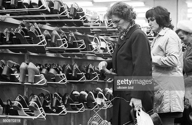 Centrum Warenhaus department store at Alexanderplatz in East Berlin, women shopping in the shoe department