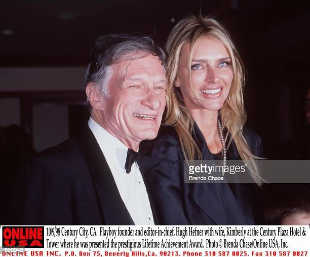 Century City CA Playboy founder and editorinchief Hugh Hefner with his wife Kimberly at the Century Plaza Hotel Tower where he was presented the...