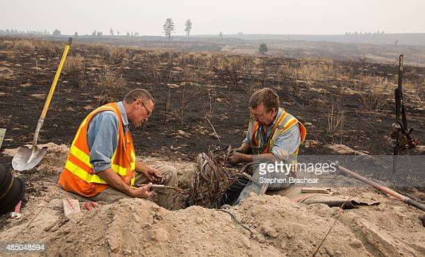 CenturyLink technicians Jeff Weigle and Steve Muehlhausen work on phone lines on the Colville Indian Reservation on August 23 2015 near Omak...