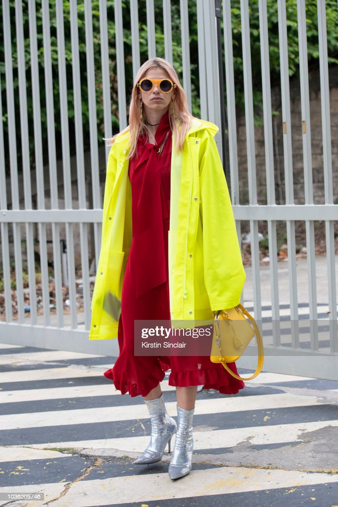 Ceo of Beyond The Mag Sophia Macks wears a Maison Margiela bag, Balenciaga boots, Calvin Klein sunglasses and a Vetements jacket and dress during Haute Couture Fall Winter 2018/2019 on July 1, 2018 in Paris, France.