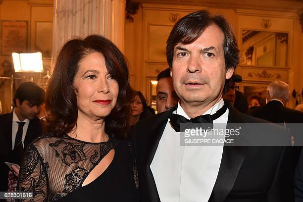 Ceo of Italian bank Intesa San Paolo Carlo Messina arrives with his wife at la Scala opera house for the Premiere of 'Madame Butterfly' on December 7...