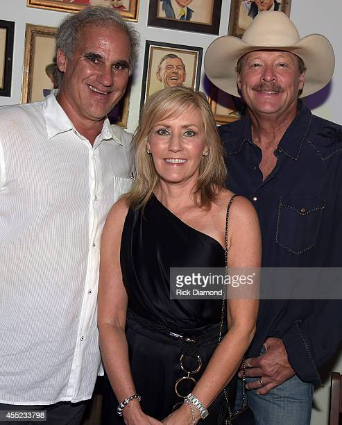 Acme Tom Morales Denise Jackson with Singer/Songwriter Alan Jackson attend Acme Feed Seed Grand Opening Party on September 10 2014 in Nashville...