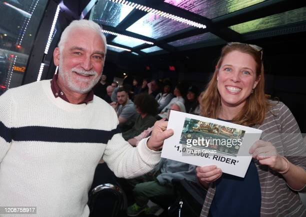 Artistic Director of The Ride Richard Humphrey and Winner Heather Hurley pose as The Ride welcomes it's 1000th Rider on the immersive bus tour of NYC...