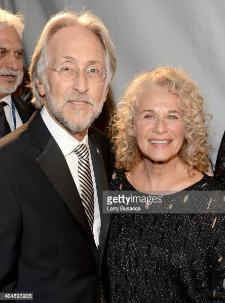 President of the National Academy of Recording Arts and Sciences Neil Portnow and honoree Carole King attend 2014 MusiCares Person Of The Year...