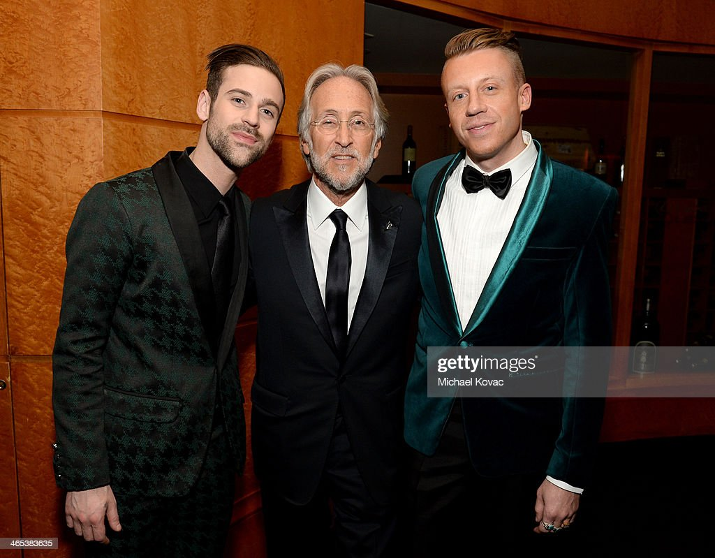 President of the National Academy of Recording Arts & Sciences Neil Portnow (C) and recording artists Ryan Lewis (L) and Macklemore (R) attend the 56th GRAMMY Awards at Staples Center on January 26, 2014 in Los Angeles, California.