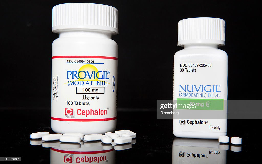 Cephalon Inc.'s Provigil and Nuvigil, both used to treat excessive sleepiness caused by narcolepsy, are arranged for photograph at a pharmacy in New York, U.S., on Wednesday, March 30, 2011. Cephalon Inc. surged 28 percent to $75.20 in Nasdaq trading, higher than a hostile takeover bid from Valeant, Canada's largest drugmaker. Valeant Pharmaceuticals International Inc. made its cash offer of about $5.7 billion, or $73 a share, public last night after its private approaches were rejected, the company said. Photographer: JB Reed/Bloomberg via Getty Images