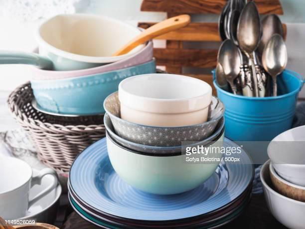 ceramic and enamel crockery on wooden background - 台所用品店 ストックフォトと画像