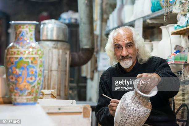 ceramic artist is working on a piece of pottery, iran - iranian culture stock pictures, royalty-free photos & images