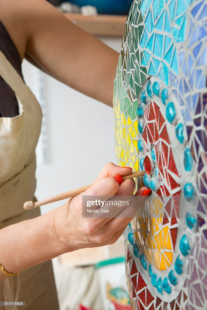 Ceramic artist working on a piece in her studio : Stock Photo