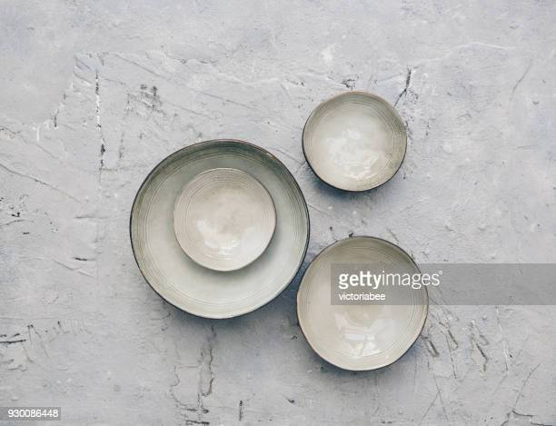 ceramic bowls on a textured background - ceramic stock photos and pictures