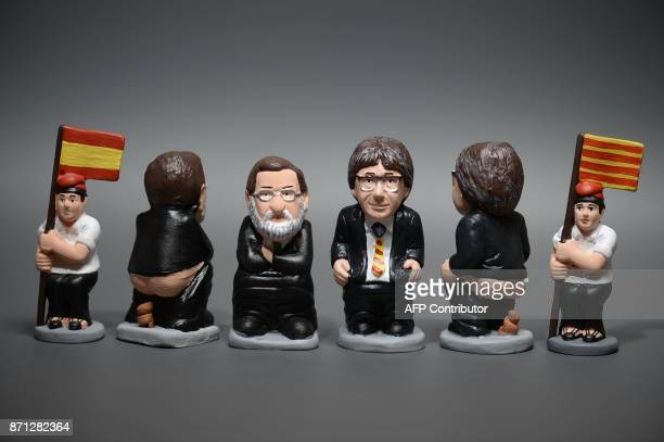 Ceramic figurines called 'caganers' representing Catalonia's deposed separatist leader Carles Puigdemont Spanish Prime Minister Mariano Rajoy and a...