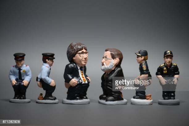 Ceramic figurines called 'caganers' representing Catalonia's deposed separatist leader Carles Puigdemont Spanish Prime Minister Mariano Rajoy Spanish...