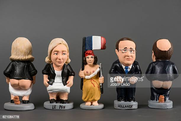 Ceramic figurines called 'caganers' representing French Front National farright party's President and European MP Marine Le Pen and French President...