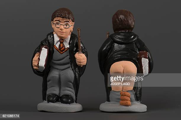 Ceramic figurines called 'caganers' representing Harry Potter are displayed at a factory in Torroella de montgri on November 4 2016 Statuettes of...