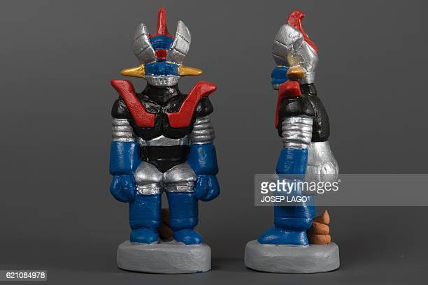 Ceramic figurines called 'caganers' representing Mazinger Z are displayed at a factory in Torroella de montgri on November 4 2016 Statuettes of...
