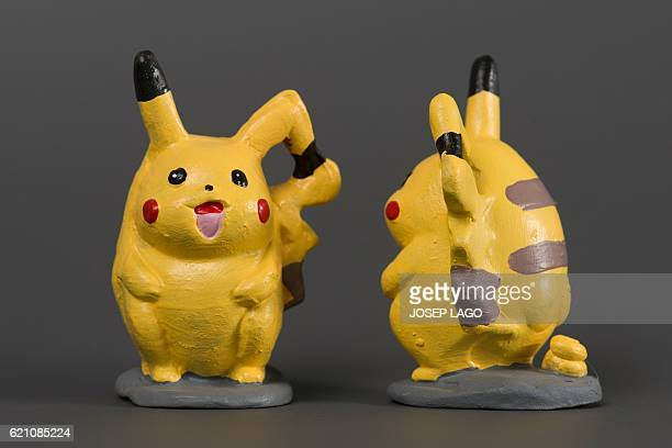 Ceramic figurines called 'caganers' representing Pokemon series character Pikachu are displayed at a factory in Torroella de montgri on November 4...