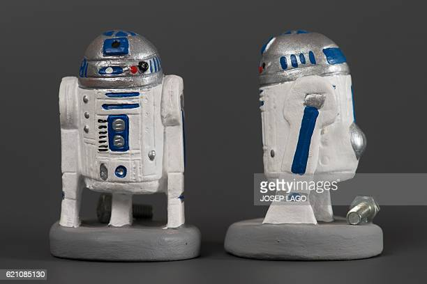 Ceramic figurines called 'caganers' representing Star Wars robot R2D2 are displayed at a factory in Torroella de montgri on November 4 2016...