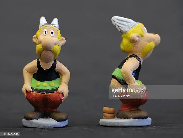 Ceramic figurines known locally as caganers of cartoon character Asterix are displayed on November 8 2011 Statuettes of wellknown people defecating...