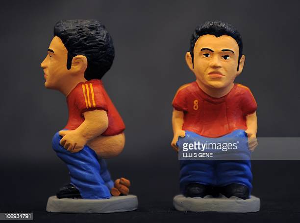Ceramic figurines of national Spanish football player Xavi Hernandez called caganers are pictured on November 17 2010 Statuettes of wellknown people...