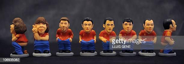 Ceramic figurines of national Spanish football players Carles Puyol Gerard Pique Xavi Hernandez Sergio Busquets David Villa and Andres Iniesta called...