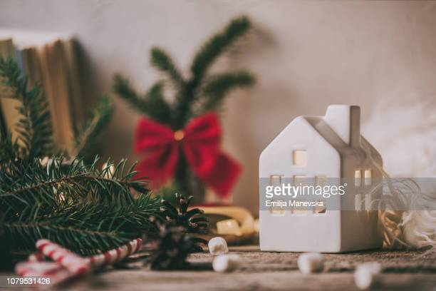 ceramic house on rustic christmas background - craft product stock pictures, royalty-free photos & images