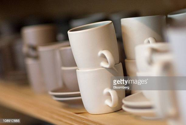 Ceramic mugs are displayed at the Heath Ceramics Ltd store at the Ferry Building in San Francisco California US on Saturday Feb 5 2011 Robin Petravic...