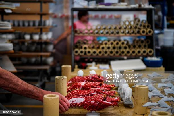 Ceramic pieces depicting lobsters are prepared for the kiln at Bordallo Pinheiro Factory in Caldas da Rainha on September 13, 2018. - Ignoring...