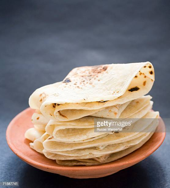 A Ceramic Plate with a Pile of Folded Rotis