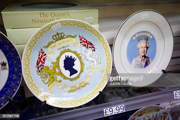 Ceramic plates celebrating the reign of Britain's Queen Elizabeth II are on sale at a gift shop in Windsor on April 20 2016 Britain's Queen Elizabeth...
