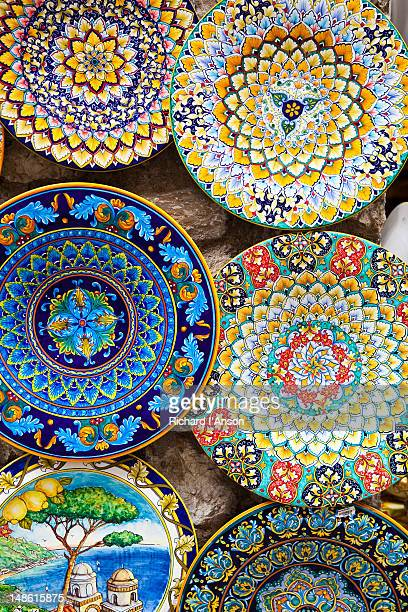 Ceramic plates for sale displayed outside shop on Piazza Duomo, Amalfi Coast.