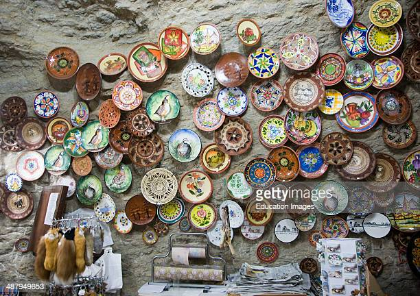 Ceramic plates on display on wall of cave shop Setenil de las Bodegas, Cadiz province, Spain.