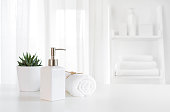 Ceramic soap, towel, copy space on blurred white spa background
