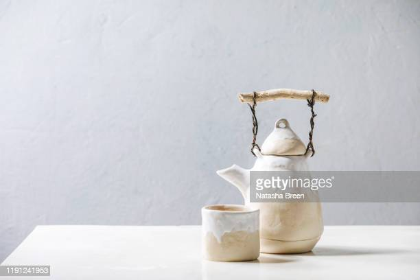 ceramic teapot and cup - household equipment stock pictures, royalty-free photos & images