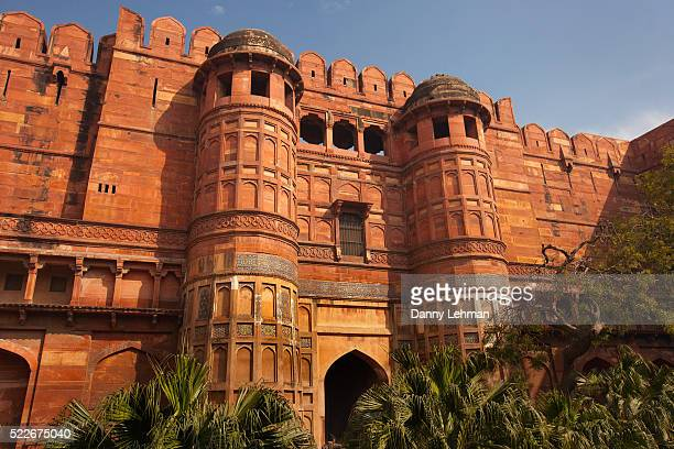 ceramic tile decorates the red sandstone walls of the agra fort - アーグラ ストックフォトと画像