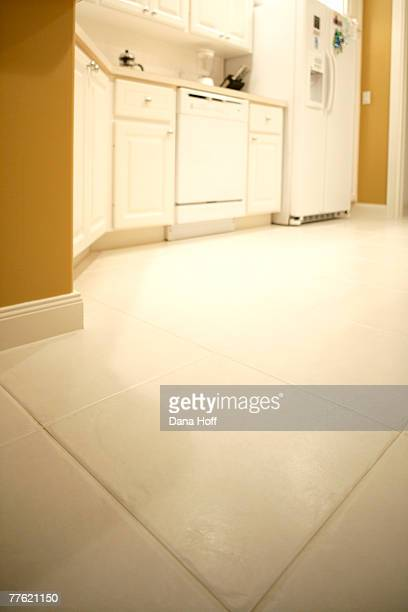 ceramic tile floor of white and yellow kitchen - dana white stock pictures, royalty-free photos & images