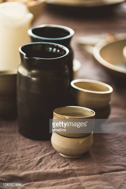 ceramics cup and jug of water on a table - mmeemil stock pictures, royalty-free photos & images